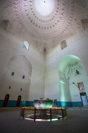 The ritual bronze large cauldronTay-KazanTurkestan, Kazakhstan - april 22, 2014:  Inside the Mausoleum of Khoja Ahmed Yasawi Editorial