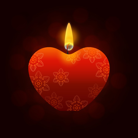 heartshaped: Heart-shaped red lighted candle with pattern of snowflakes and yellow flames on dark background