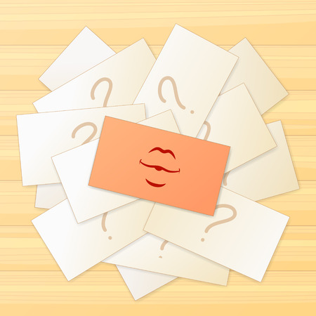 cheerfulness: Pile of cards with a question sign and one card with a kiss sign on top of this pile