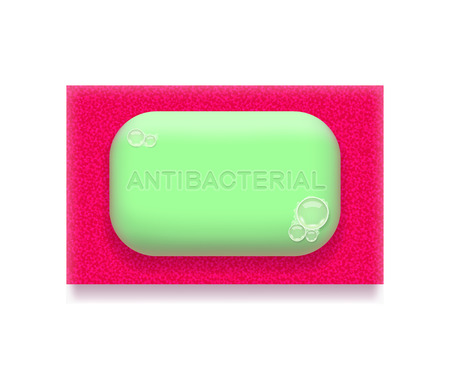 antibacterial: Green antibacterial soap is lying on bright pink sponge, on white background. Hygiene and health concept