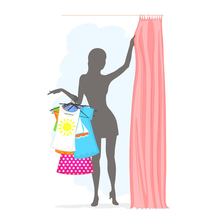 fitting room: Slender woman is holding many clothes on hangers and pulling the curtain in the fitting room. Summer female shopping.