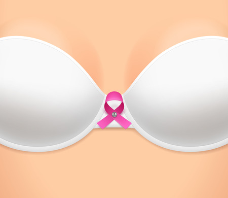 skin cancer: Womans breast dressed in white bra and pink loop-shaped ribbon as symbol of breast cancer awareness