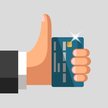 profitable: Plastic bank cards in hand of businessman. Thumb up gesture. Profitable card concept