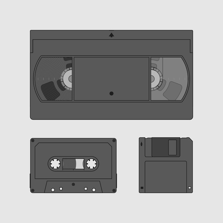 outdated: Videocassette, compact cassette and floppy disk. Retro storage devices. Outdated technology concept. Black and white image