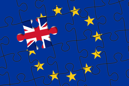 geopolitics: European Union flag in form of assembled jigsaw puzzle, one piece is missing, flag of United Kingdom instead. British withdrawal from the EU. Brexit concept