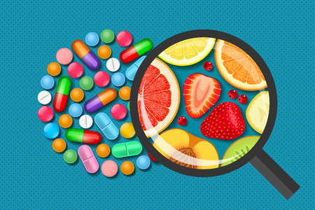 Pile of multicolored tablets and pills and magnifying glass with different fruits and berries inside. Vitamins in nature and in medicinal products. Medicine and health concept