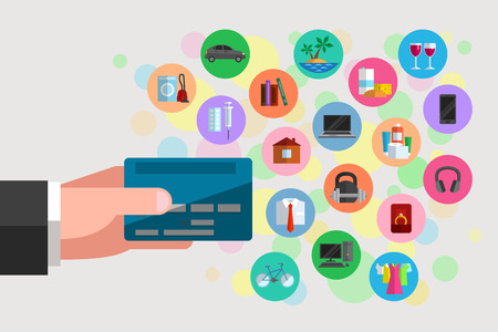 Mans hand is holding a plastic bank card. Icons of various goods and services nearby. Possible purchases and spendings available by using bank debit or credit card