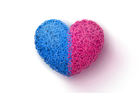 weaved: Heart weaved from variety of twisted blue and pink threads. Heterosexual couple concept.