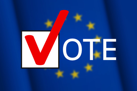 Check-box with big red check mark and letters nearby are forming together the word vote, on blurred flag of the European Union on background. Elections, voting and active civic position Stock Photo