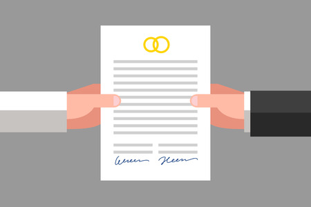 Prenuptial agreement in man and woman hands. Family and law concept