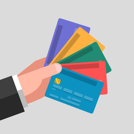 Various colored bank cards in one hand. Different cards for different cases Illustration