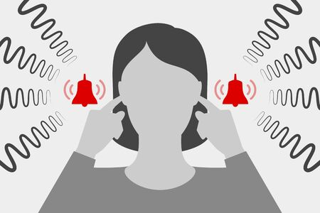 Woman is covering her ears with hands and suffering from tinnitus
