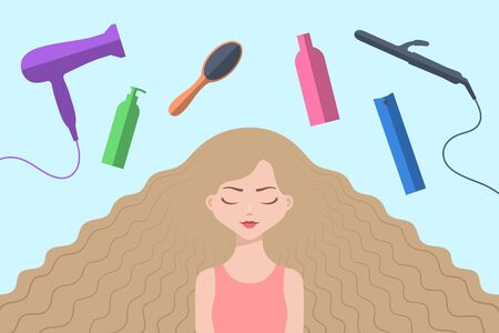 Cute girl with eyes closed and with long loose blond hair flowing downwards. Different haircare accessories are nearby. Concept of hair care, healthy hair and beauty treatments