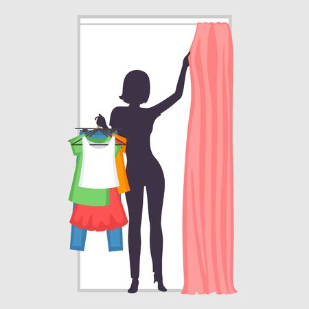 Young woman is holding many different clothes on hangers in one hand and pulling curtain in fitting room with another hand. Slender silhouette. Modern female shopping and difficulties of choices