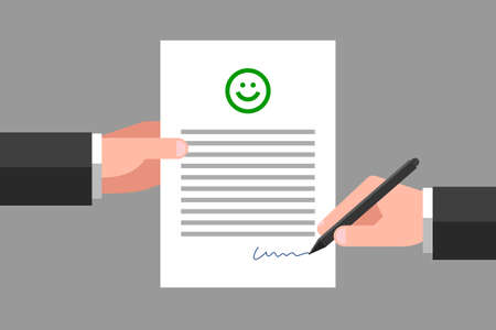 One hand is holding paper with happy smiling face icon and text, another hand is signing it. Concept of good review, positive feedback, customer satisfaction about service or product quality