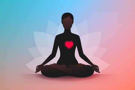 Dark silhouette of slender woman sitting in lotus position, dreaming with eyes closed, relaxing and meditating. Her red heart is glowing. Concept of harmony and tranquility in heart and thoughts
