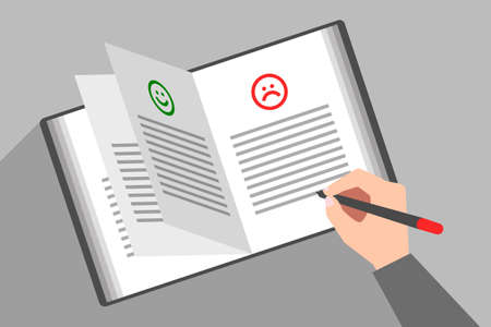 Person's hand is writing text under unhappy sad face icon in book of comments and suggestions. Concept of bad review, negative feedback, customer complaints about service or product quality