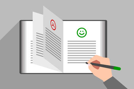 Person's hand is writing text under happy smiling face icon in book of comments and suggestions. Concept of good review, positive feedback, customer satisfaction about service or product quality