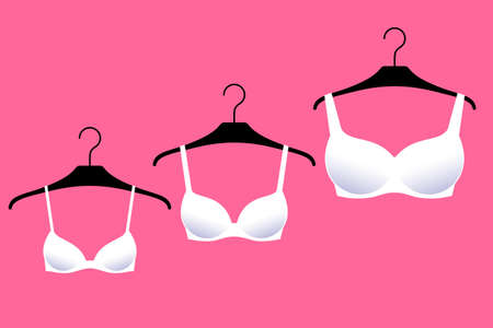 Three white brassieres with cups of different sizes are on hangers over bright pink background. Lingerie for small, medium and large female breasts. Diversity of bra sizes, fashion and beauty trends  イラスト・ベクター素材