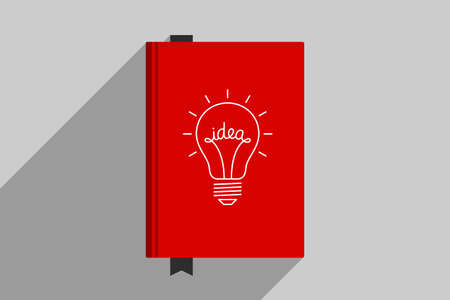 Red book with picture of light bulb at cover, personal book for writing genial ideas. Concept of generator of ideas, creative person, author creativity
