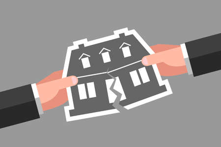 Two hands are tearing icon of house over gray background. Concept of division of property, real estate, inheritance partition, or foreclosure