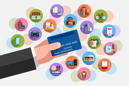 Bank plastic card in person's hand and plenty of icons of goods around it. Concept of purchasing power, cashless payment for goods and services, purchases on credit Vettoriali