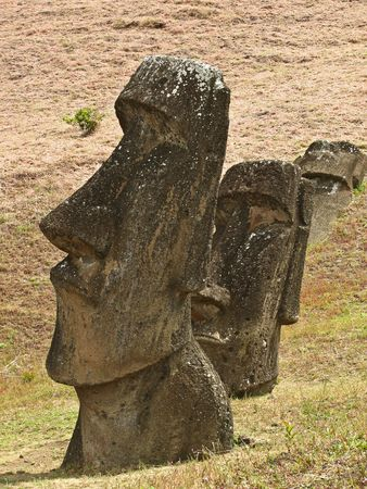 moai: Moai statues on the slope of Rano  Raraku, Rapa Nui. Stock Photo