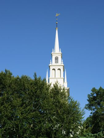 Anglican church above the trees, Newport, RI Stock Photo
