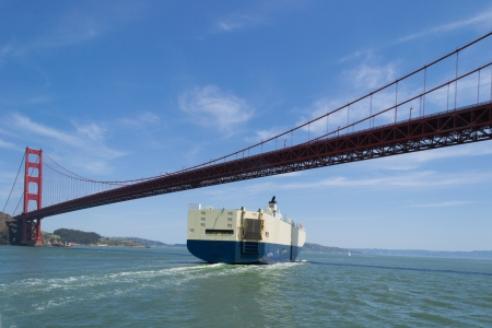 The ship is entering the bay of San Fransisco under the Golden Gate bridge Stock Photo