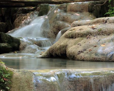 Erawan waterfalls in a forest river in Thailand photo