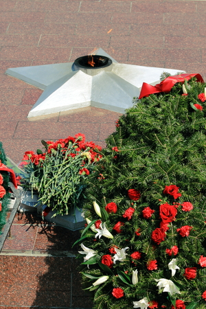 laid wreaths and flowers at the eternal flame in memory of the heroes of World War II photo
