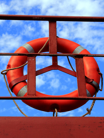 conspicuous: marine lifebuoy on Leer ship on a background of blue sky Stock Photo