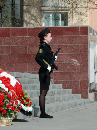 garrison: Young girl in naval uniform with a weapon in the honor guard at the Eternal Flame