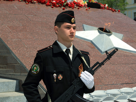 eternal: a student with a gun on watch at the eternal flame in Vladivostok