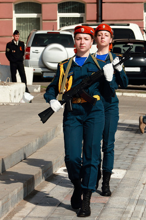 girl cadet of EMERCOM of Russia marching with weapons in their hands Redakční