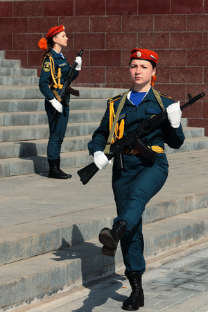 beautiful young girl cadet of EMERCOM of Russia in uniform is photographed at the memorial with arms Redakční