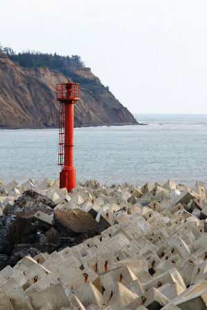 decapods: navigation lighthouse on Cape fortified decapod Stock Photo