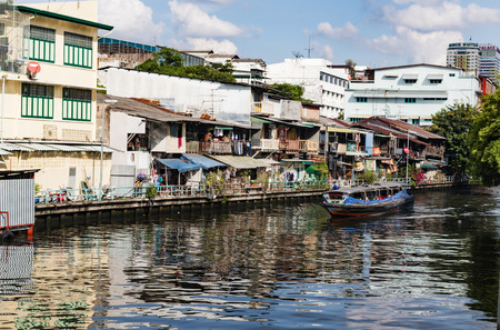 house float on water: the river canals of Bangkok are used by residents to travel by boats through the city