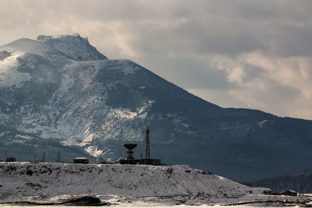 tectonics: the Russian town of Yuzhno-Kurilsk at the foot of the volcano on the island Kunashir