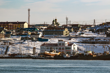 kuril: boat at the pier in the port of the Russian city of Yuzhno-Sakhalinsk on the island of Kunashir