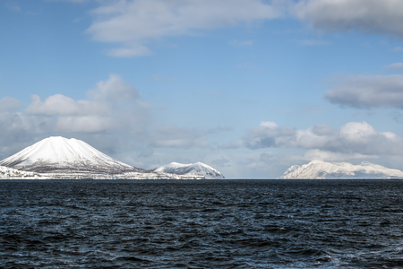 inhospitable: volcano in the winter on the island in the clouds Stock Photo
