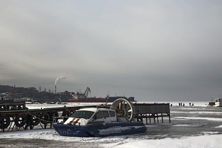 hovercraft: rescue hovercraft frozen sea of ??Vladivostok on duty near the pier