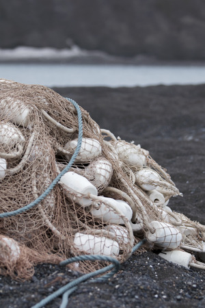 spawn: fishing net svlen in a heap on the Black shore of Chukotka Stock Photo