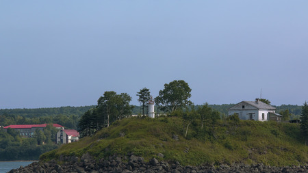 White lighthouse and caretakers house lighthouse Stock fotó