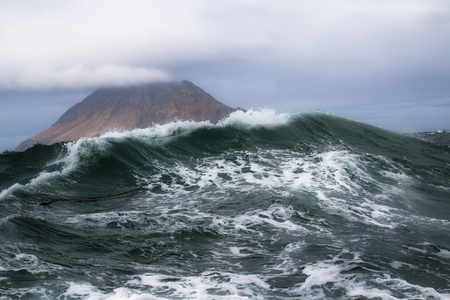 Sea wave on the background of the Kuril Islands