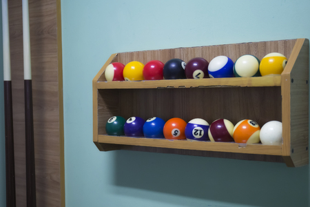 billiard balls on the shelf