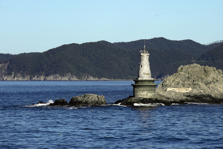 lighthouse Maritime dangerous rocky Cape Foto de archivo