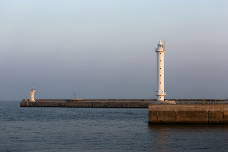 lighthouses in the evening light on the pier Foto de archivo