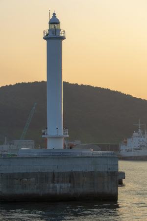 pier with a lighthouse at sunset in the South Korean city of Busan