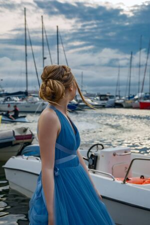 Girl in blue evening dress